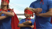 manto : Super family crossing hands on chest in superhero pose, parents and kid together Vídeos