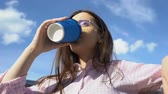 tea time : Female writer drinking coffee outdoors, hoping for inspiration, tough morning Stock Footage