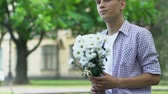 belirsiz : Boy holding flowers, waiting for girlfriend on date, nervous, insecure teenager