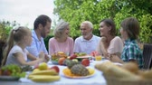 eating outside : Friendly family having lunch in country house, social care, financial security