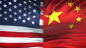 pequim : United States and China flags background, diplomatic and economic relations Stock Footage