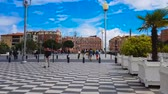 apolo : People go sightseeing on Massena square in Nice, enjoying city attractions