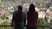gözcü : Man and woman standing on observation deck and enjoying city panorama view