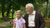 earnest : Grandpa telling grandson interesting things, sharing knowledge and experience