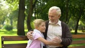 earnest : Grandson runs up to grandfather, embraces him, secured old age and family values