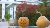 oyma : Pumpkin Jack on table in yard, preparation for Halloween party, creativity