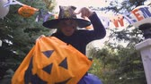 procura : Little witch kid demands sweets, children trick-or-treating, Halloween event