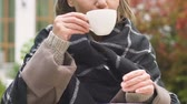mulled : Woman having cup of cocoa sitting on garden terrace, warming up on cold fall day