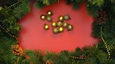 stopmotion : Gold christmas balls forming circle on decorated with spruce branches background