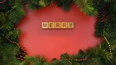 stopmotion : Merry Christmas phrase made of cubes, preparation of festive greeting cards