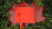 stopmotion : Satin ribbon wrapping around big red giftbox and tying in cute bow, decoration Stock Footage