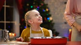 magdalenas : Smiling girl secretly tasting chocolate muffin, Christmas preparations childhood