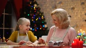 pamięć : Cheerful grandma and girl giving high-five, preparations for holiday finished