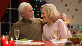 sylwester : Retiree couple hugging and looking to camera, happy family portrait on Xmas eve
