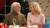 прочный : Elderly man and woman having date on Xmas eve, flirting and having good time