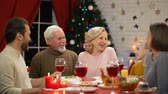 scaring : Happy family having traditional Xmas dinner, little girl telling funny stories