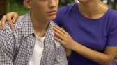 apathetic : Mother supporting her upset son, listening his problems in school, bullying
