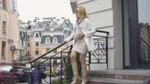 downstairs : Modern expecting businesswoman going carefully downstairs, urban maternity Stock Footage