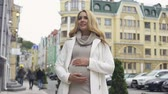 anyaság : Blond stylish mother-to-be stroking belly, childbirth expectation, happiness