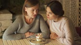 svést : Female friends deciding to avoid eating sugary desserts, moving plate away