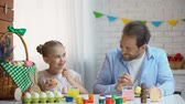 home painting : Cute father and daughter preparation for Easter celebration painting eggs