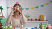 egg painted : Cheerful woman putting Easter eggs to eyes having fun and enjoying bright fest