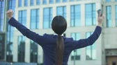 уведомление : Extremely joyful lady making cheerful gesture, woman in business, back view