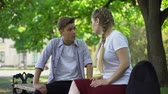 annoyance : Teenagers arguing in park, break up because of misunderstanding.