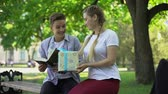 予期している : Teen girlfriend presenting birthday box to boyfriend in park, surprise present