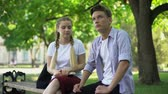 ignorieren : Indifferent teens sitting on bench, bad blind date, wasting time, ignoring