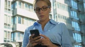 phone bad : Frustrated business lady reading bad-news message on mobile phone, dismissal