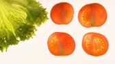 de baixa caloria : Cut tomatoes and lettuce on white background, ecological products, gmo free Stock Footage