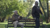 travessura : Aged man joking with friend kicking butt, friendship humor, having fun, leisure Vídeos