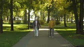 старение : Two happy senior women walking in park, nursing home for elderly people, leisure Стоковые видеозаписи