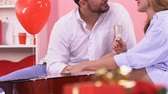 afecto : Couple drinking wine and kissing, celebrating anniversary, gift and rose closeup