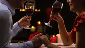 san valentin : Couple in love chatting drinking red wine, cozy Saint Valentines Day celebration Archivo de Video