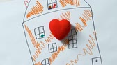 imaginação : Childs hands putting toy heart on drawing of house, orphan dreaming of home
