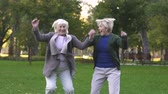 versicherung : Middle-age women jumping from happiness, rejoice in increase in living standards