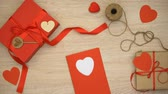 parabéns : Hand made Valentines greeting card on wooden background near craft gift boxes Vídeos