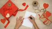 parabéns : Hand writing love word on paper, craft gift boxes on background, Valentines Day