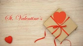 san valentin corazones : St Valentines Day phrase appearing on wooden background with craft gift box