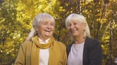 longevity : Two old women smiling at camera, trustful relations, friends for life concept