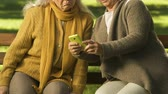 chocado : Two old women using smartphone, amazed with modern technologies, learning app