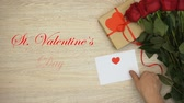 carte d amour : St Valentines Day phrase, hand putting envelope near bunch of roses and gift box