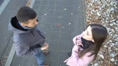 refusal : Young couple walking on street, woman blaming and pushing boyfriend, break up