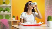 tasteful : Pretty woman drinking from paper glass in canteen, junk food overeating, snack Stock Footage