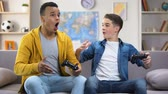 dormitory : European and Afro-American friends enjoying video games, spending free time