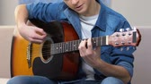 engaged : Interested teenager playing acoustic guitar, amateur musical hobby, free time