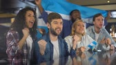 supporting : Excited sport fans with Argentina flag celebrating victory of national team