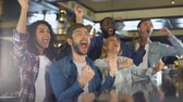 supporting : Group of sport fans watching game in bar, rejoicing victory of favorite team